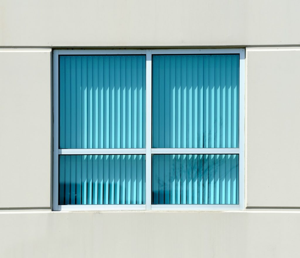 Turquoise blinds from outside the office