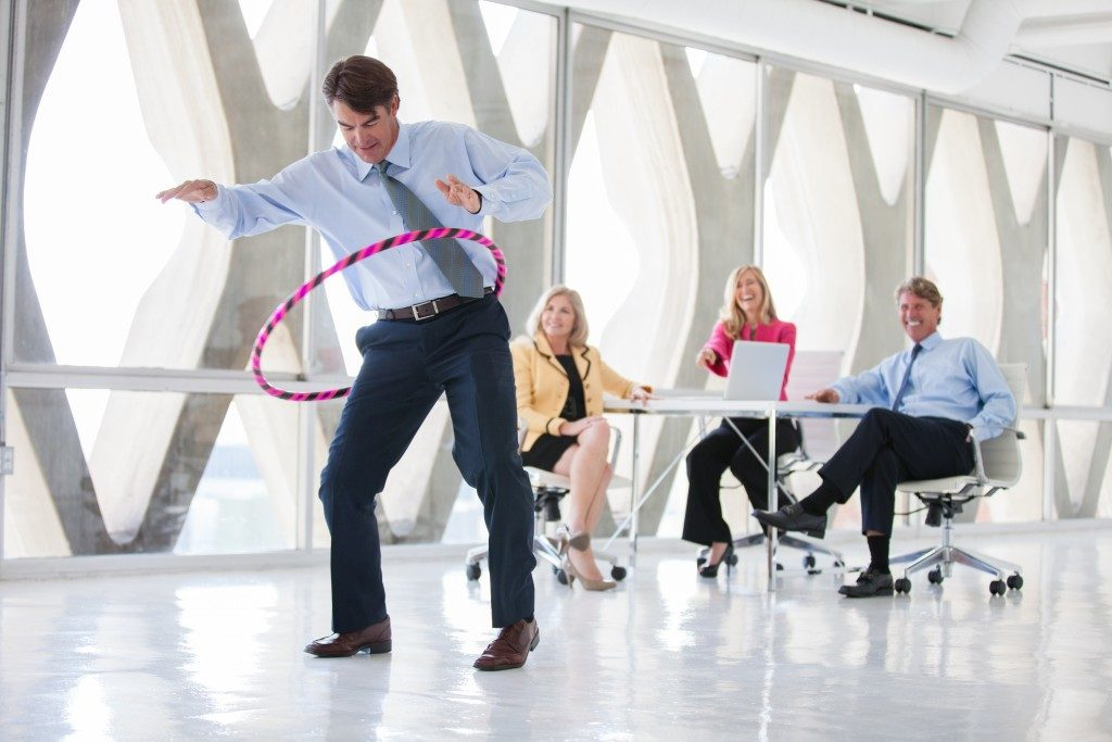 employees doing hulahoop