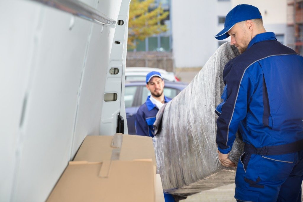 movers loading couch into van