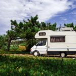Touristic caravan staying in a forest
