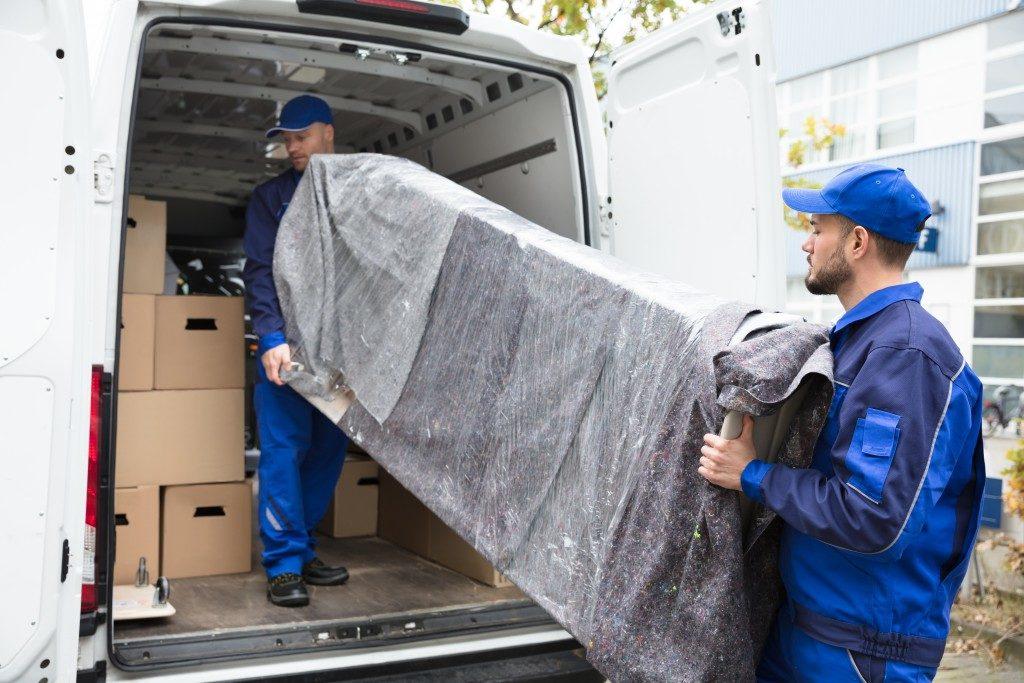 furniture being loaded up in van