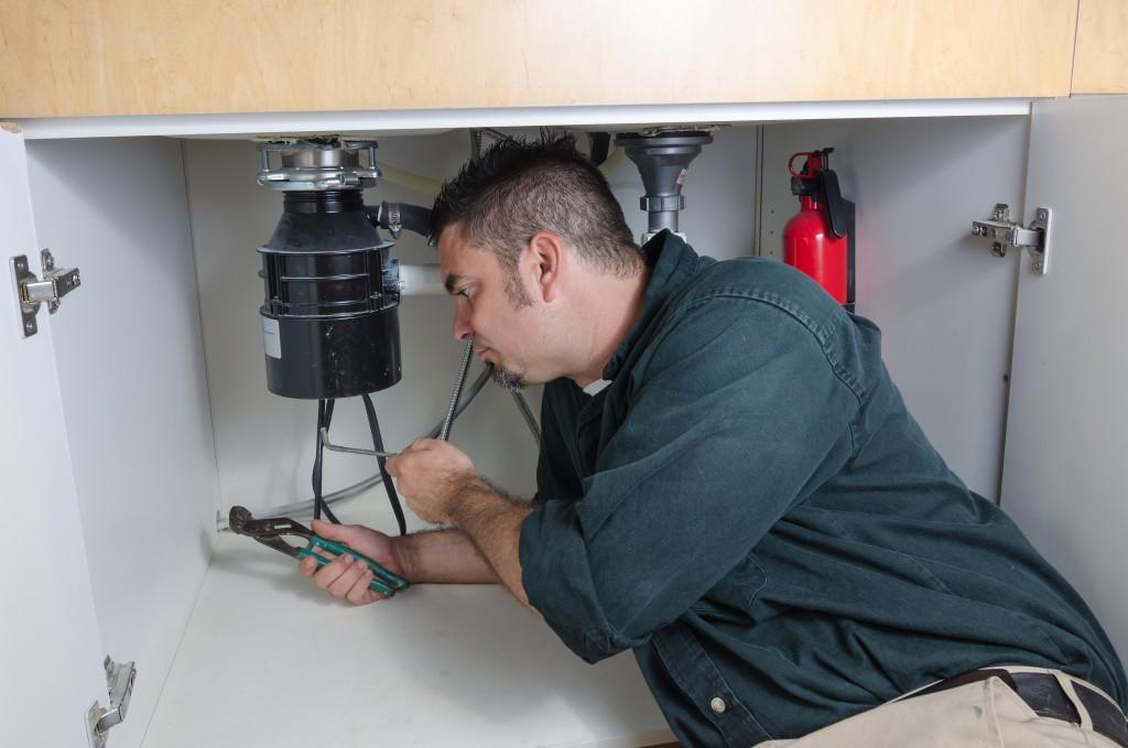 man repairing the sink