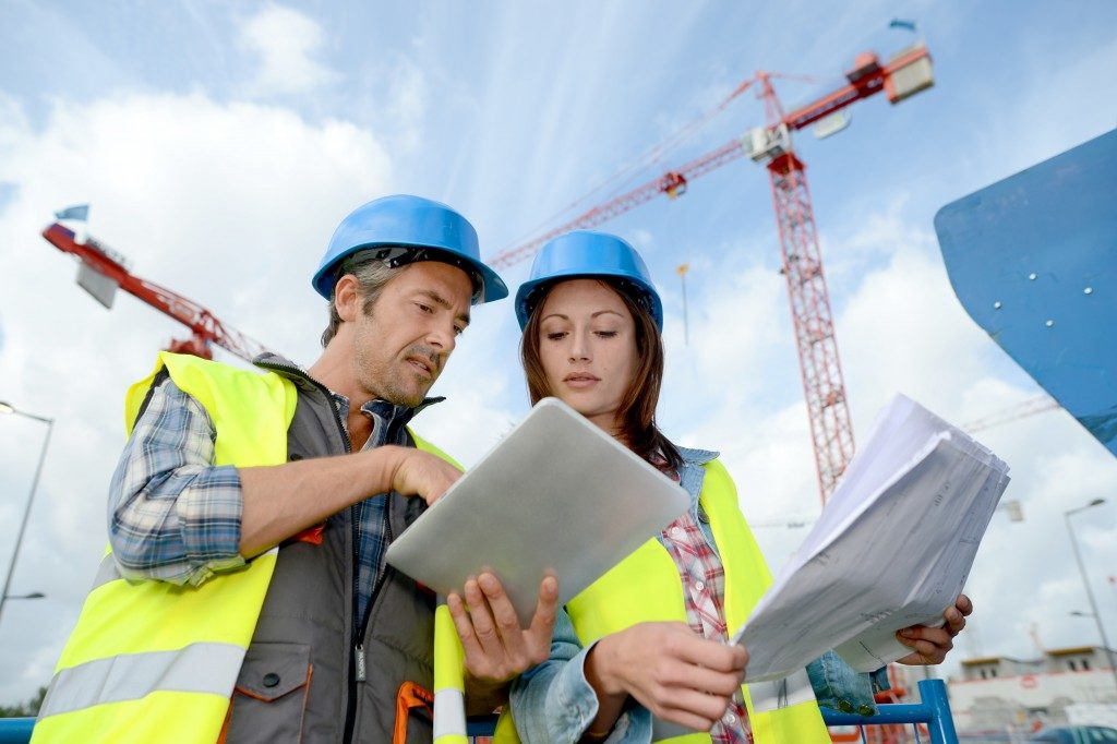 2 people studying the building construction