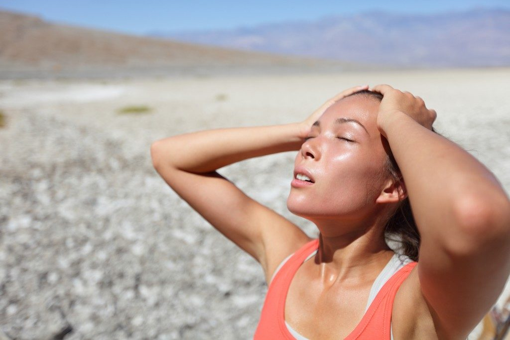 woman suffering from heat stress