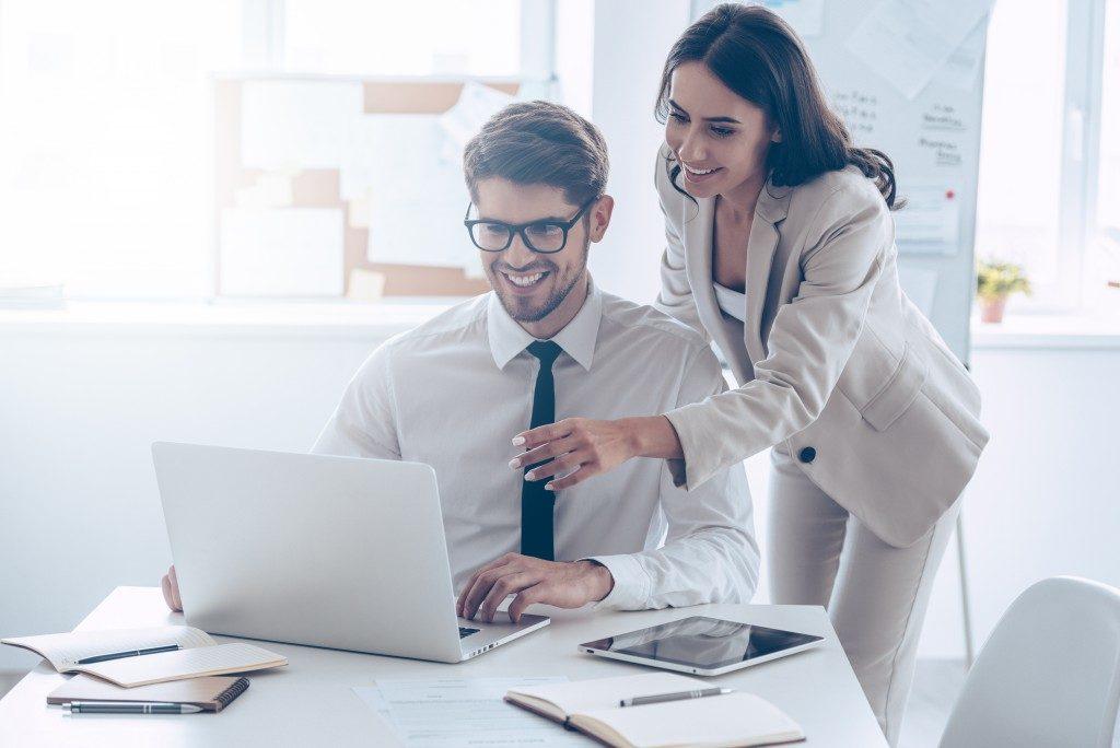 Marketing team working using laptop