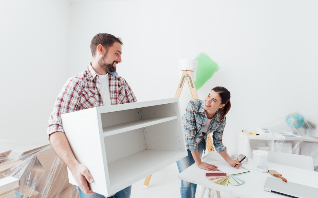 man and woman moving furnitures