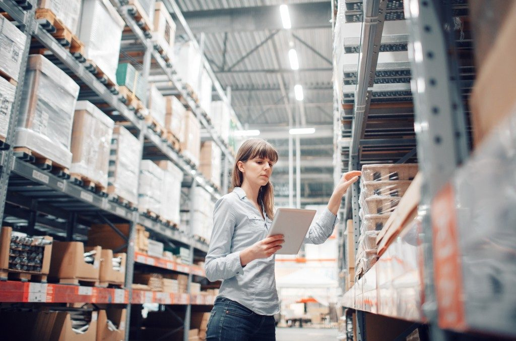 Woman checking storage in warehouse