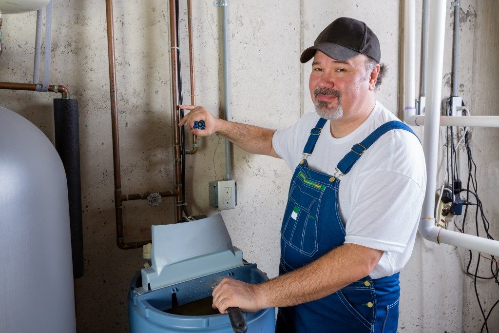 professional plubmer checking on water tank