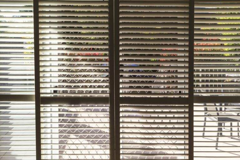 Plantation style elegant shutters window treatment for stylish home