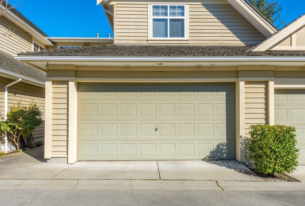 Garage door in front of house