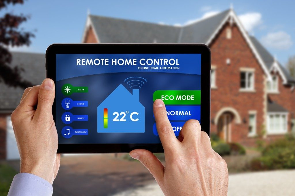 Holding a smart energy controller or remote home control online home automation