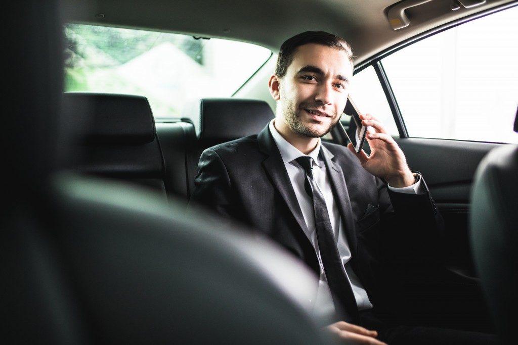 Businessman riding an uber