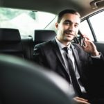 Businessman riding an uber