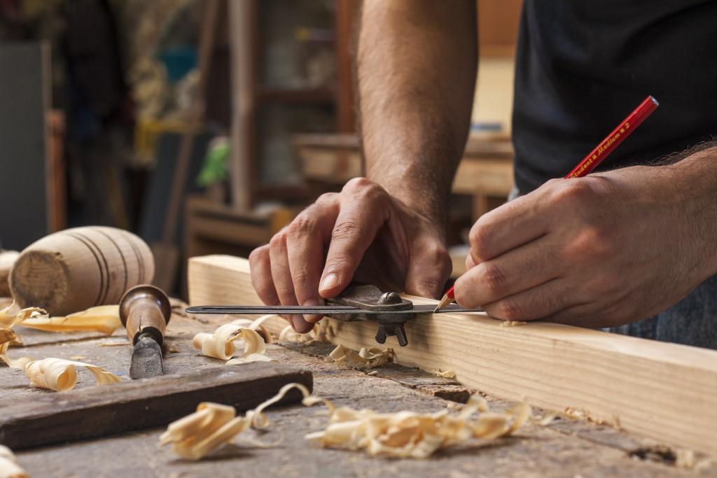 man doing woodcraft