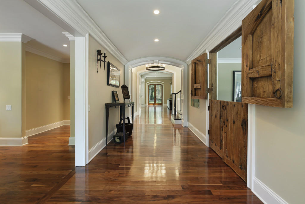 Long foyer with wooden barn doors into living room