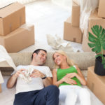 couple on the floor unpacking