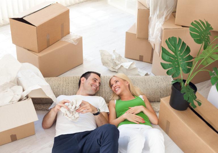 couple on the floor unpacking