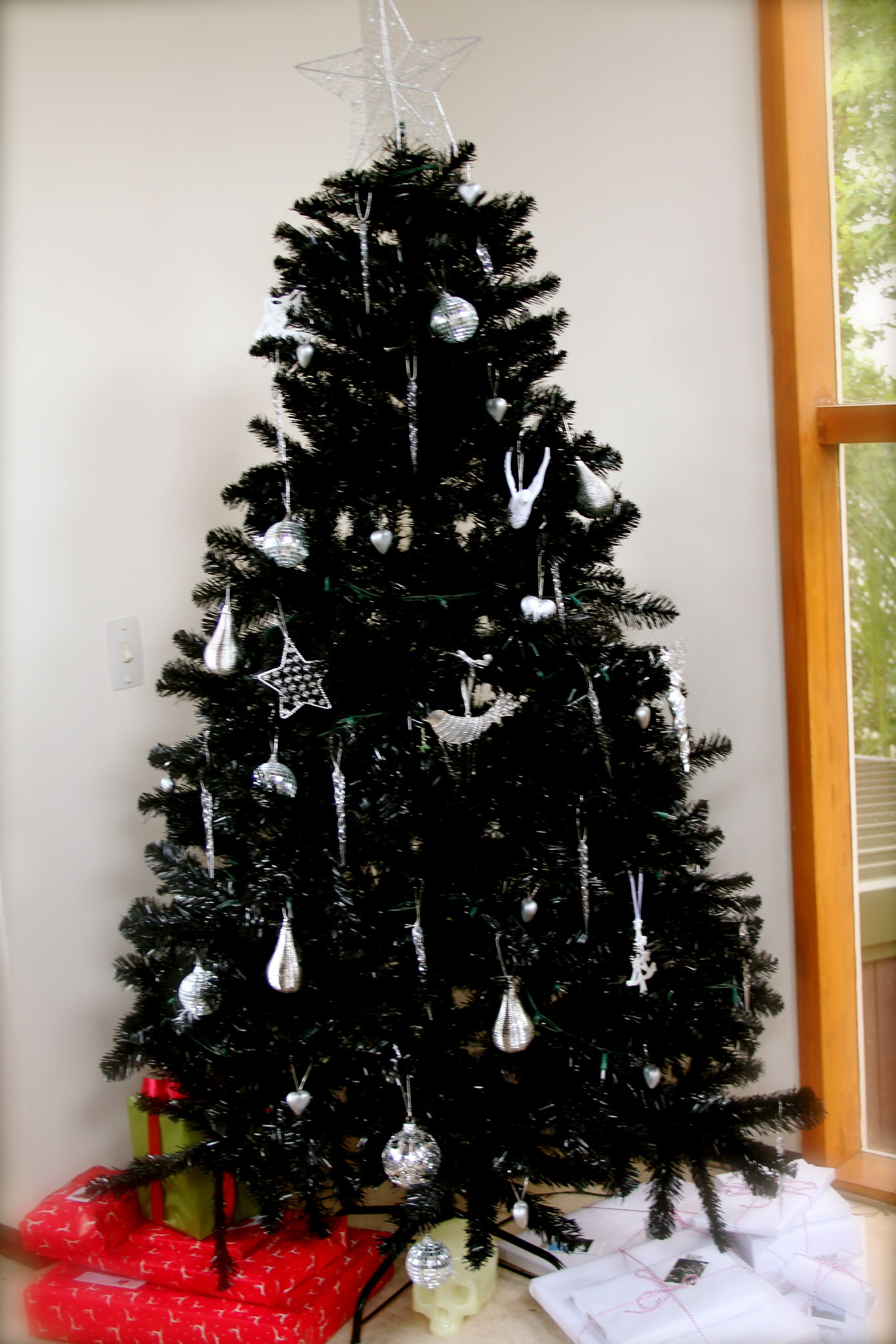black tree with ornaments