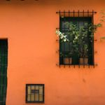 orange house with window bars