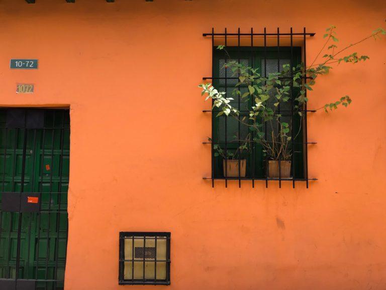 orange house with window bars