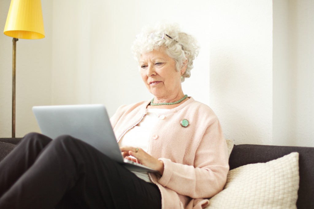 grandmother using a laptop at home